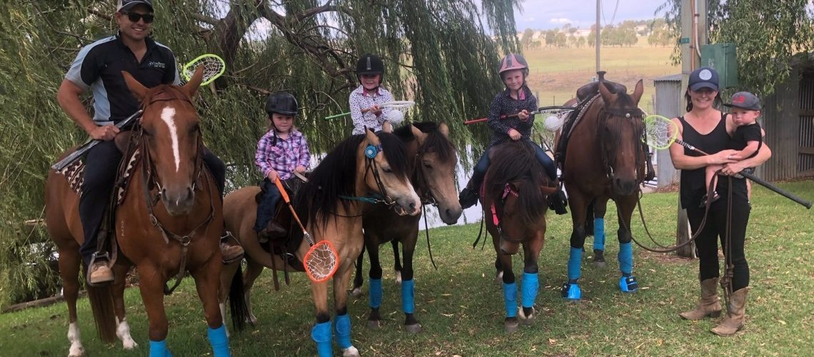 Young family from Jugiong practicing Blue Bandage Polocrosse